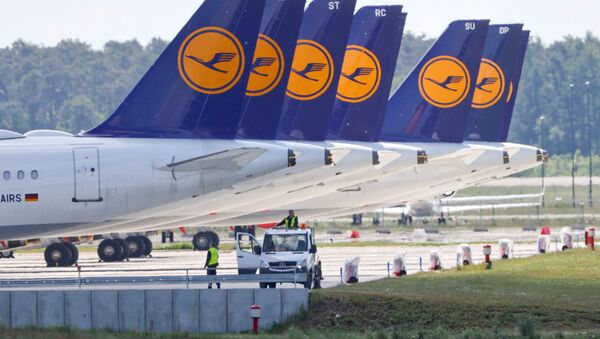 FILE PHOTO: Airplanes of German carrier Lufthansa are parked at the Berlin Schoenefeld airport, amid the spread of the coronavirus disease (COVID-19) in Schoenefeld, Germany, May 26, 2020 - Sputnik International