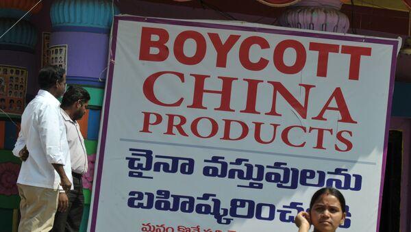 Members of the Ganesh Utsav Committee stand alongside a poster declaring 'Boycott China Products' in Hyderabad on November 3, 2016. - Sputnik International