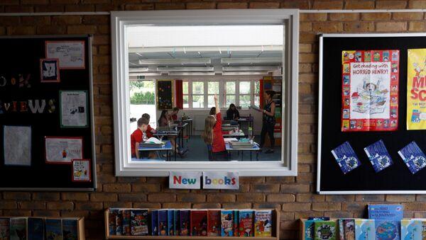 Children are seen in a classroom at Watlington Primary School as some schools re-open, following the outbreak of the coronavirus disease (COVID-19), Watlington, Britain, June 1, 2020 - Sputnik International