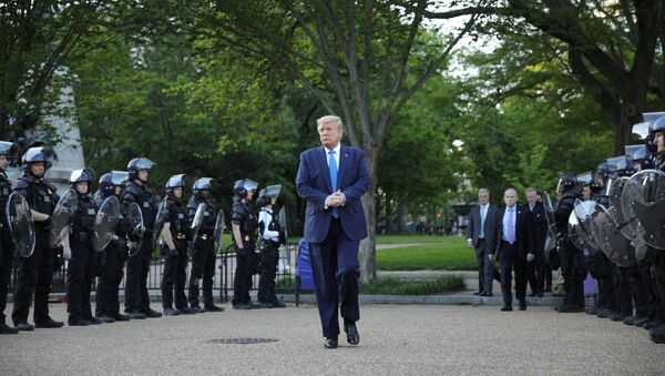 U.S. President Donald Trump walks between lines of riot police in Lafayette Park across from the White House after walking to St John's Church for a photo opportunity during ongoing protests over racial inequality in the wake of the death of George Floyd while in Minneapolis police custody, at the White House in Washington, U.S., June 1, 2020. - Sputnik International