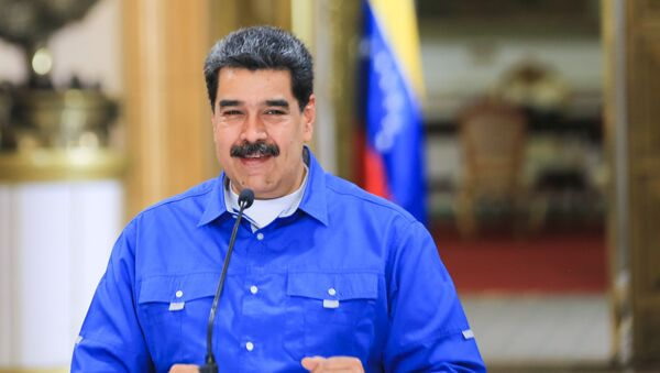 Handout picture released by Venezuelan Presidency showing Venezuelan President Nicolas Maduro speaking during a video conference meeting with members of his cabinet, at Miraflores Presidential Palace in Caracas, on June 1, 2020 - Sputnik International