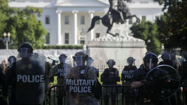 DC National Guard military police officers look on as demonstrators rally near the White House against the death in Minneapolis police custody of George Floyd, in Washington, D.C., U.S., June 1, 2020 - Sputnik International