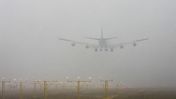A plane lands at the Indira Gandhi International Airport through morning fog, in New Delhi, India - Sputnik International