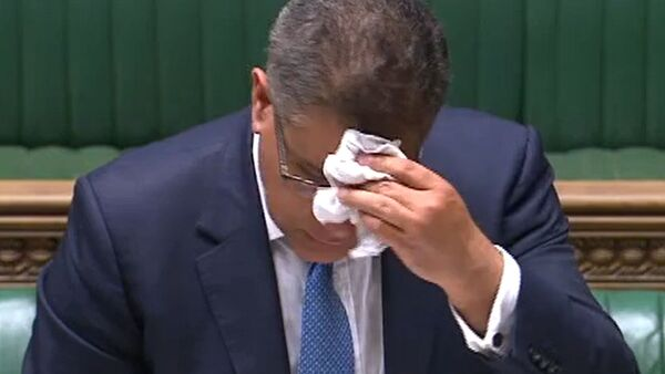 A video grab from footage broadcast by the UK Parliament's Parliamentary Recording Unit (PRU) shows Britain's Business Secretary Alok Sharma wiping his brow as he makes a statement in the House of Commons in London on June 3, 2020, as lockdown measures ease during the novel coronavirus COVID-19 pandemic - Sputnik International