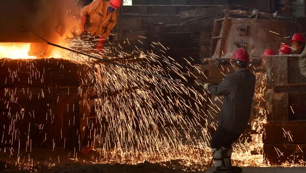 This photo taken on March 15, 2020 shows workers pouring molten steel at a foundry in Wuyi, China's eastern Zhejiang province - Sputnik International