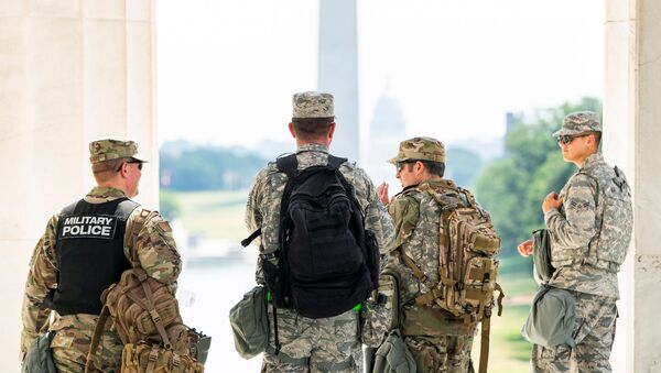 Members of the DC National Guard gear-up after a short rest from standing guard at the Lincoln Memorial during protests in DC over the death of George Floyd, in Washington, D.C., U.S., June 4, 2020 - Sputnik International