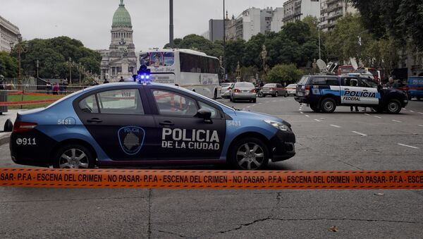- Police cars are parked at a crime scene in Buenos Aires, Argentina, Thursday, May 9, 2019. - Sputnik International