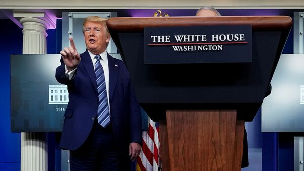 U.S. President Donald Trump stops a reporter from asking Dr. Anthony Fauci a question about use of the drug hydroxychloroquine to treat the disease caused by the new coronavirus near the end of the daily coronavirus task force briefing at the White House in Washington, U.S., April 5, 2020 - Sputnik International