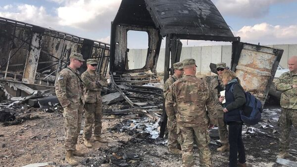 U.S. Soldiers stand amid damage at a site of Iranian bombing at Ain al-Asad air base, in Anbar, Iraq, Monday, Jan. 13, 2020. Ain al-Asad air base was struck by a barrage of Iranian missiles on Wednesday, in retaliation for the U.S. drone strike that killed atop Iranian commander, Gen. Qassem Soleimani, whose killing raised fears of a wider war in the Middle East.  - Sputnik International
