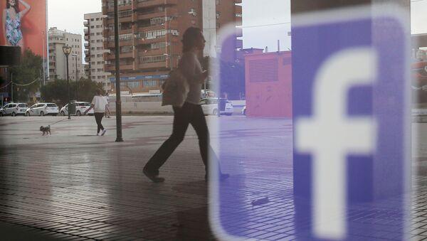 Facebook logo is seen on a shop window in Malaga, Spain, June 4, 2018 - Sputnik International