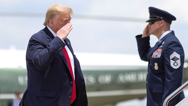 U.S. President Donald Trump returns a salute while boarding Air Force One as he departs Washington for travel to Guilford, Maine at Jont Base Andrews, Maryland, U.S., June 5, 2020. - Sputnik International