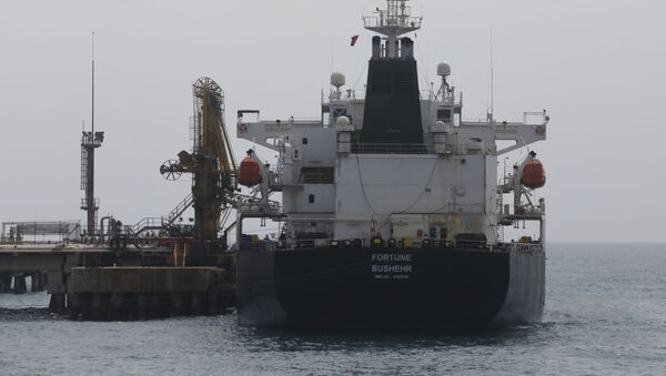 Iranian oil tanker Fortune is anchored at the dock of the El Palito refinery near Puerto Cabello, Venezuela, Monday, May 25, 2020. - Sputnik International