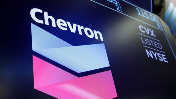 The logo for Chevron appears above a trading post on the floor of the New York Stock Exchange, Friday, 16 August 2019 - Sputnik International