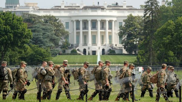 Uniformed military personnel walk in front of the White House ahead of a protest against racial inequality in the aftermath of the death in Minneapolis police custody of George Floyd, in Washington, U.S. June 6, 2020 - Sputnik International