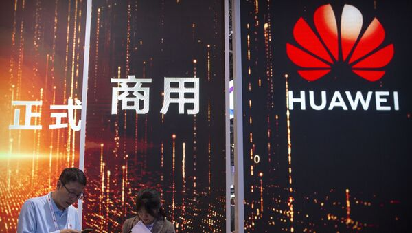 In this Oct. 31, 2019 photo, attendees use their smartphones near a Huawei booth at the PT Expo technology conference in Beijing. Chinese tech giant Huawei is racing to develop replacements for Google apps. U.S. sanctions imposed on security grounds block Huawei from using YouTube and other popular Google core apps. - Sputnik International