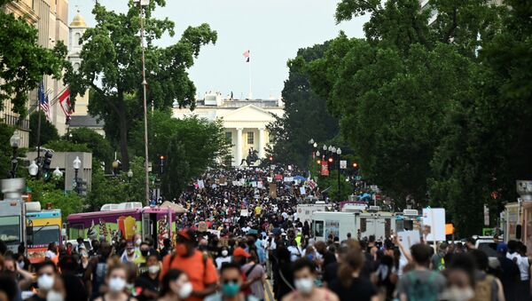 Demonstrators march on 16th St. near the White House, during a protest against racial inequality in the aftermath of the death in Minneapolis police custody of George Floyd, in Washington, U.S. June 6, 2020 - Sputnik International