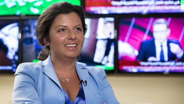 In this photo taken on Friday, Jan. 19, 2018, Margarita Simonyan, the head of the Russian television channel RT, smiles during an interview with the Associated Press in Moscow, Russia.  - Sputnik International