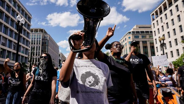 Protesters march against the death in Minneapolis police custody of George Floyd, near the White House in Washington, U.S., June 7, 2020.   - Sputnik International
