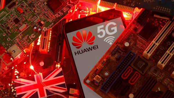 FILE PHOTO: The British flag and a smartphone with a Huawei and 5G network logo are seen on a PC motherboard in this illustration picture taken January 29, 2020. REUTERS/Dado Ruvic/File Photo - Sputnik International