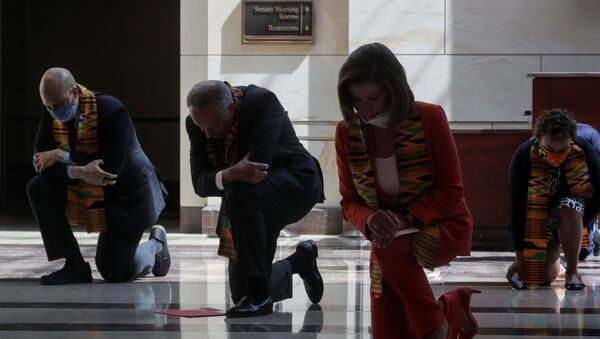 U.S. House Speaker Nancy Pelosi (D-CA) and Senate Minority Leader Chuck Schumer (D-NY) kneel with Congressional Democrats during a moment of silence to honor George Floyd, Breonna Taylor, Ahmaud Arbery and others inside Emancipation Hall after weeks of protests against racial inequality in the aftermath in Minneapolis police custody of Floyd, at the U.S. Capitol in Washington, U.S., June 8, 2020 - Sputnik International
