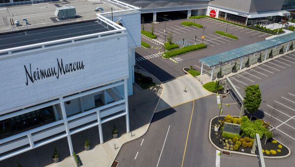 A Neiman Marcus department store stands next to empty parking lots at the King of Prussia Mall which remains closed due to the ongoing outbreak of the coronavirus disease (COVID-19) in Upper Merion Township, Pennsylvania U.S., May 21, 2020 - Sputnik International