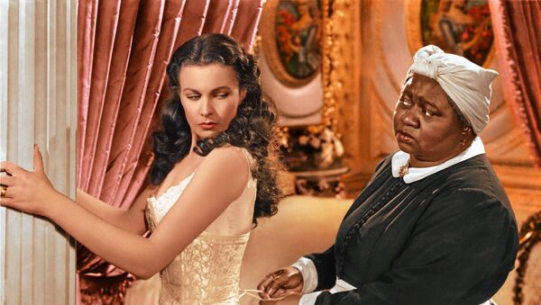 In this image released by Turner Classic Movies, Vivien Leigh appears in character as Scarlett O'Hara, left, and Hattie McDaniel as Mammy, in the film, Gone with the Wind.  75 years after the premiere of the movie, Gone with the Wind, research is shedding light on the racial tensions that existed at the time between the producer and City of Atlanta officials. Emory University film studies professor, Matthew Bernstein, has conducted extensive research into the archives of the film's producer, David O. Selznick. His findings illustrate some of Selznick's concerns with the city's treatment of the film's black stars at the Dec. 15, 1939 premiere - Sputnik International