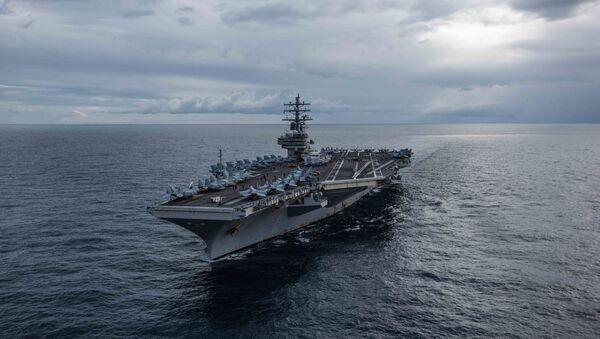 The U.S. Navy's forward-deployed aircraft carrier USS Ronald Reagan (CVN 76) cruises during Talisman Sabre 2019.  - Sputnik International