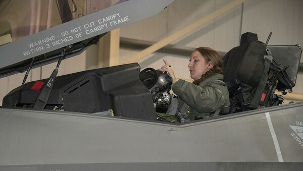 U.S. Air Force Capt. Emily Thompson, 421st Expeditionary Fighter Squadron pilot, dons her helmet prior to a mission on the Al Dhafra Air Base, United Arab Emirates, flightline June 5, 2020. Thompson is the first female to fly an F-35A Lightning II into combat. She is currently deployed from Hill Air Force Base, Utah - Sputnik International