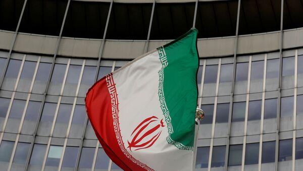 An Iranian flag flutters in front of the International Atomic Energy Agency (IAEA) headquarters in Vienna, Austria, September 9, 2019.   - Sputnik International