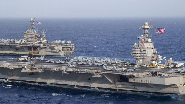 The Ford-class aircraft carrier USS Gerald R. Ford (CVN 78) and the Nimitz-class aircraft carrier USS Harry S. Truman (CVN 75) transit the Atlantic Ocean June 4, 2020 - Sputnik International