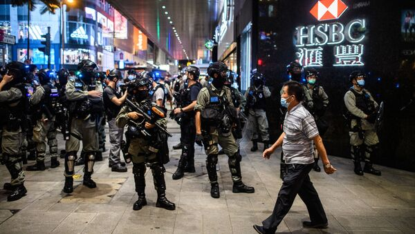 Police secure an area in the Central district of Hong Kong on June 9, 2020, as the city marks the one-year anniversary since pro-democracy protests erupted following opposition to a bill allowing extraditions to mainland China.  - Sputnik International