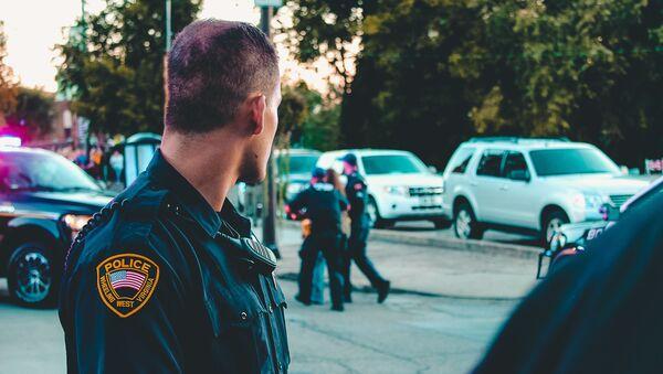 Man wearing black officer uniform - Photo by Rosemary Ketchum from Pexels - Sputnik International