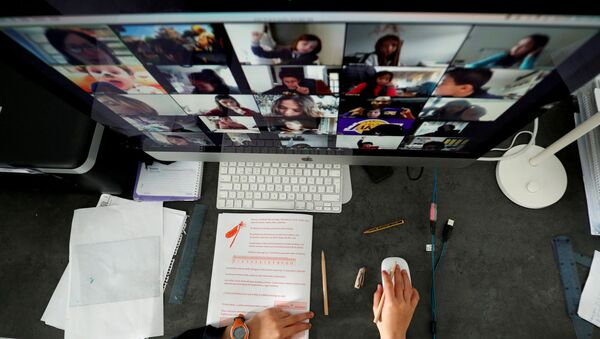 A student takes classes online with his companions using the Zoom app at home during the coronavirus disease (COVID-19) outbreak in El Masnou, north of Barcelona, Spain April 2, 2020 - Sputnik International