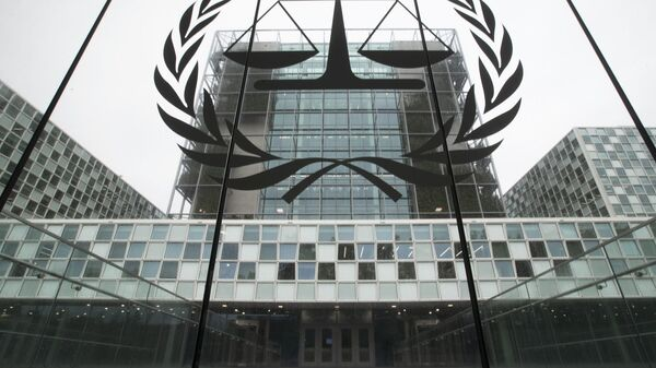 FILE- In this Nov. 7, 2019 file photo, the International Criminal Court, or ICC, is seen in The Hague, Netherlands. President Donald Trump has lobbed a broadside attack against the International Criminal Court. He's authorizing economic sanctions and travel restrictions against court workers directly involved in investigating American troops and intelligence officials for possible war crimes in Afghanistan without U.S. consent. The executive order Trump signed on Thursday marks his administration's latest attack against international organizations, treaties and agreements that do not hew to its policies. (AP Photo/Peter Dejong, File) - Sputnik International