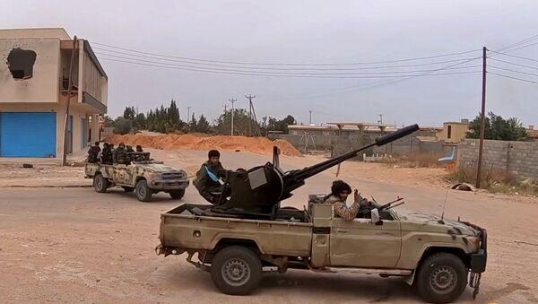 Fighters loyal to Haftar on a road south of the capital Tripoli - Sputnik International