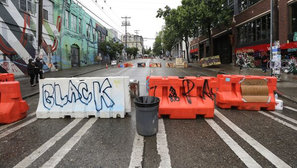 Barricades line a street near a closed Seattle police precinct Tuesday, June 9, 2020, in Seattle, following protests over the death of George Floyd, a black man who was in police custody in Minneapolis. - Sputnik International