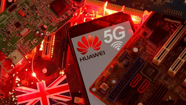 The British flag and a smartphone with a Huawei and 5G network logo are seen on a PC motherboard in this illustration picture taken 29 January 2020. - Sputnik International
