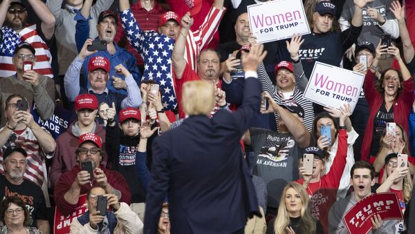 President Donald Trump waves at the audience as he leaves the stage during a campaign rally, Monday, Feb. 10, 2020, in Manchester, N.H.  - Sputnik International