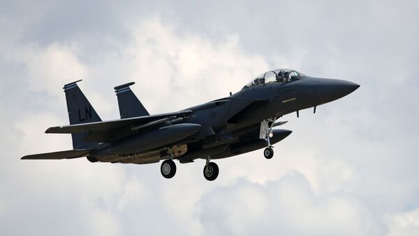 A US Air Force (USAF) F-15E Eagle fighter jet, is pictured as it prepares to land at RAF (Royal Air Force) Lakenheath, east of England, on June 15, 2020. - Sputnik International
