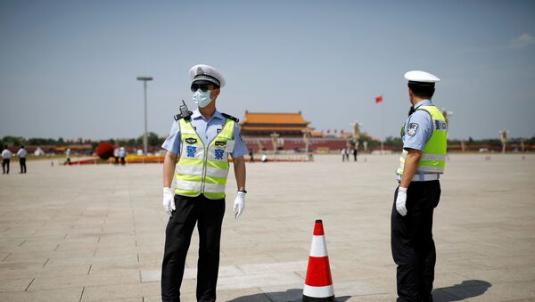 Police officers wearing face masks following the coronavirus disease (COVID-19) outbreak stand on Tiananmen Square before the closing session of the National People's Congress (NPC) in Beijing, China May 28, 2020. - Sputnik International
