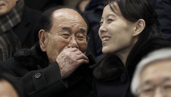 Kim Yo Jong, sister of North Korean leader Kim Jong Un, right, and North Korea's nominal head of state Kim Yong Nam, talk as they for the start of the preliminary round of the women's hockey game between Switzerland and the combined Koreas at the 2018 Winter Olympics in Gangneung, South Korea, Saturday, Feb. 10, 2018.  - Sputnik International