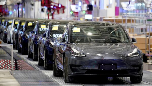 FILE PHOTO: Tesla China-made Model 3 vehicles are seen during a delivery event at its factory in Shanghai - Sputnik International