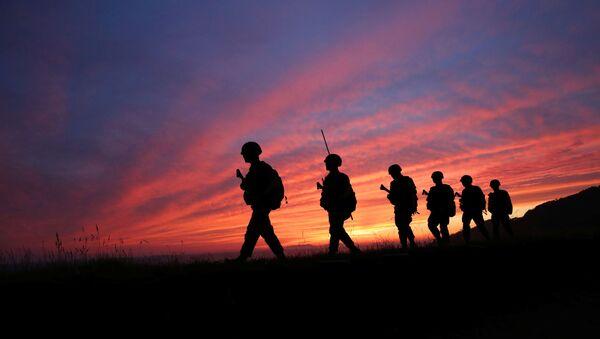 Members of South Korean marine corps patrol during sunset in Yeonpyeong island near the northern limited line, South Korea, June 16, 2020.  - Sputnik International