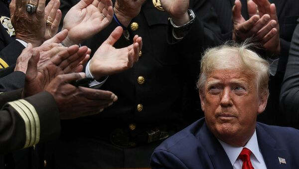 U.S. President Donald Trump listens to applause after signing an executive order on police reform during a ceremony in the Rose Garden at the White House in Washington, U.S., June 16, 2020 - Sputnik International