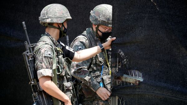 South Korean soldiers check an entrance of their guard post near the demilitarized zone separating the two Koreas in Paju, South Korea, June 16, 2020 - Sputnik International