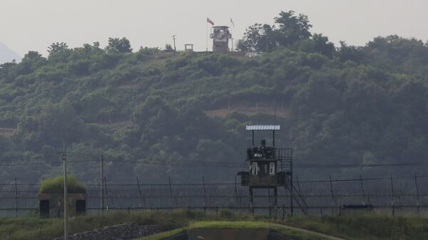 Military guard posts of North Korea, rear, and South Korea, foreground, are seen in Paju, at the border with North Korea, South Korea, Tuesday, June 16, 2020 - Sputnik International