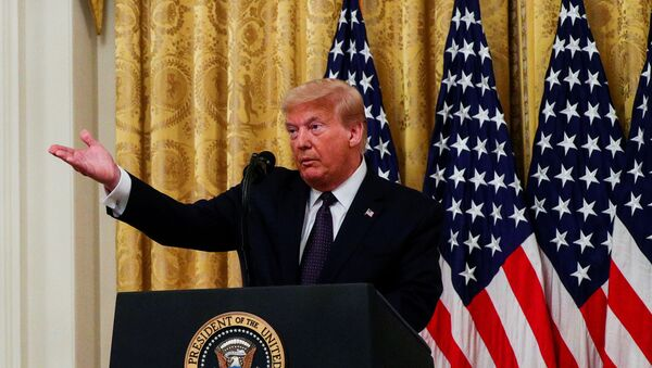 U.S. President Donald Trump discusses a Trump administration plan aimed at helping to prevent suicides by U.S. veterans and other Americans, in the East Room at the White House in Washington, U.S., June 17, 2020 - Sputnik International