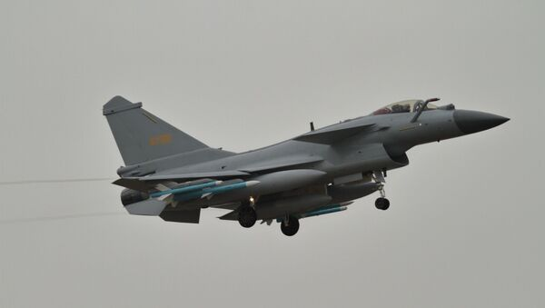 A Chengdu J-10 fighter of the Chinese People's Liberation Army Air Force (PLAAF) carrying PL-10 and PL-12 air-to-air missiles landing at Zhuhai Jinwan airport ahead of Airshow China 2018 - Sputnik International
