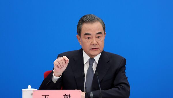 Chinese State Councillor and Foreign Minister Wang Yi speaks to reporters via video link at a news conference held on the sidelines of the National People's Congress (NPC), from the Great Hall of the People in Beijing, China May 24, 2020. - Sputnik International