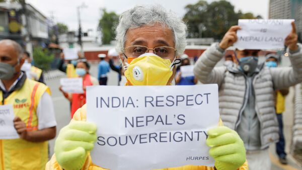 Activists affiliated with 'Human Rights and Peace Society Nepal' holding placards protest against the alleged encroachment of Nepal's border by India in the far west of Nepal, near the Indian Embassy in Kathmandu, Nepal May 12, 2020.  - Sputnik International